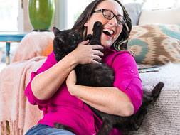 Video Library woman holding cat on couch